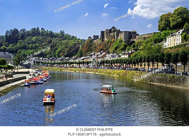 Paddle boats with tourists on the Semois river in front of Château de Bouillon Castle in summer, Luxembourg Province, Belgian Ardennes, Belgium