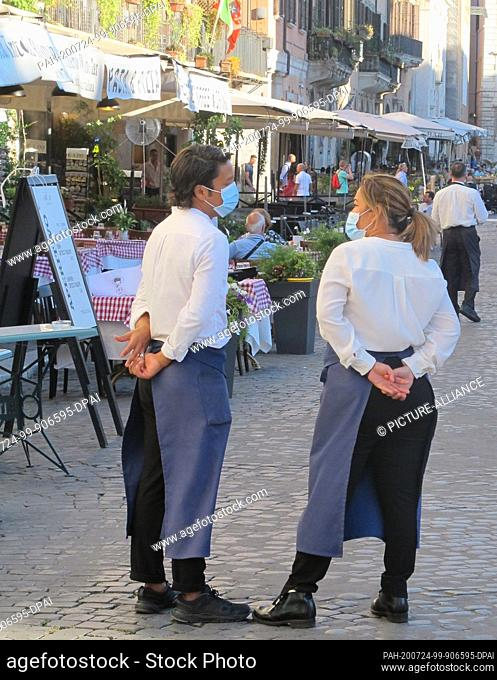 18 July 2020, Italy, Rom: Waiters and waitresses wait for customers at the Piazza Navona. The number of foreign tourists in Italy's capital is extremely low due...