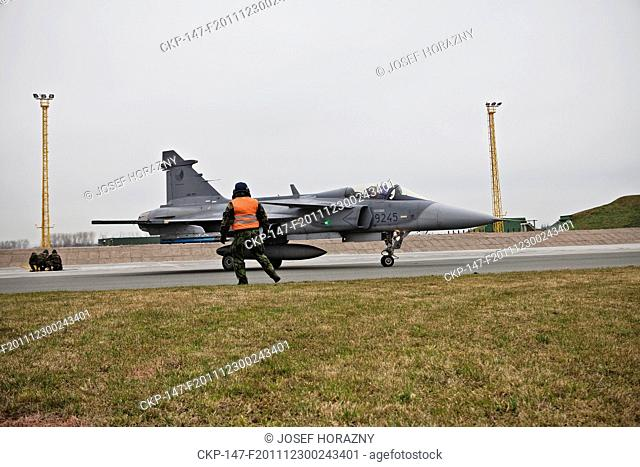 Ground crew for Czech Airforce SAAB JAS 39 Gripen, multirole jet fighters, of the 211th tactical squadron prepare for training flights from the 21st Tactical...
