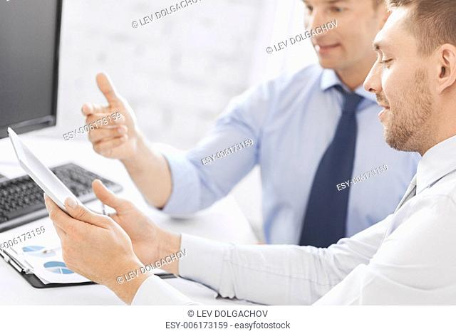 business and office concept - businessmen with notebook and tablet pc