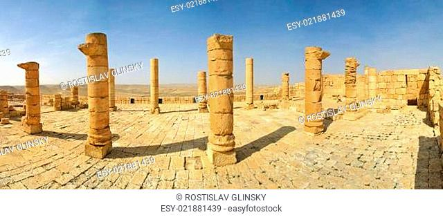 Columns and ancient ruins of old town of Avdat founded and inhabited by Nabataeans in desert of Negev in Israel (panorama)