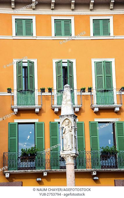 Ancient sign colon on Piazza delle Erbe: the beautiful market square in Verona, northern Italy's Veneto region, Europe