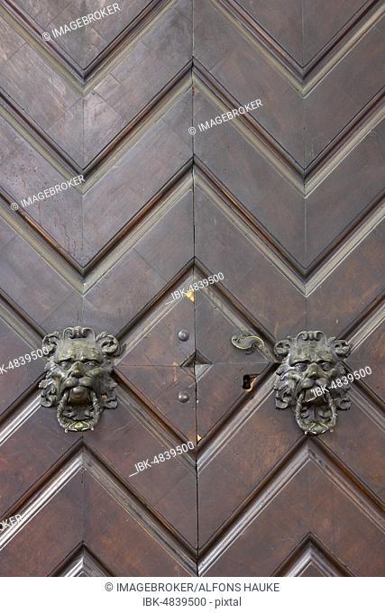Lion heads as door knockers, Bolzano, South Tyrol, Italy, Europe