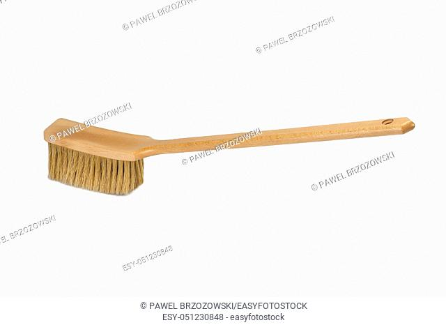 Bench brush with wooden handle isolated on white background. Dust brush or counter duster on white background