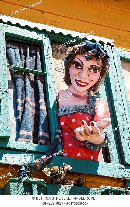 Typical colourful house in the La Boca neighbourhood with large figure of a woman, Buenos Aires, Argentina, South America