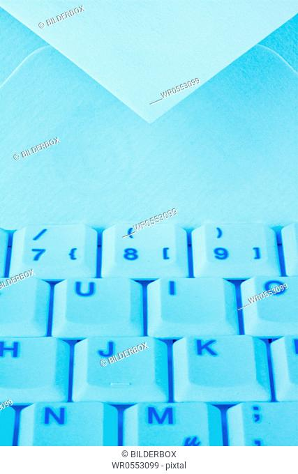The keyboard of a computer and an envelope.Communication via e-mail