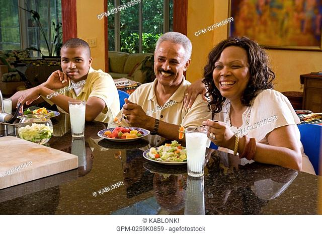 Portrait of African American family eating healthy meal