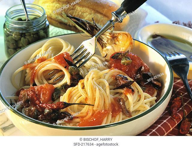 Spaghetti alla puttanesca with tomato, anchovies and capers