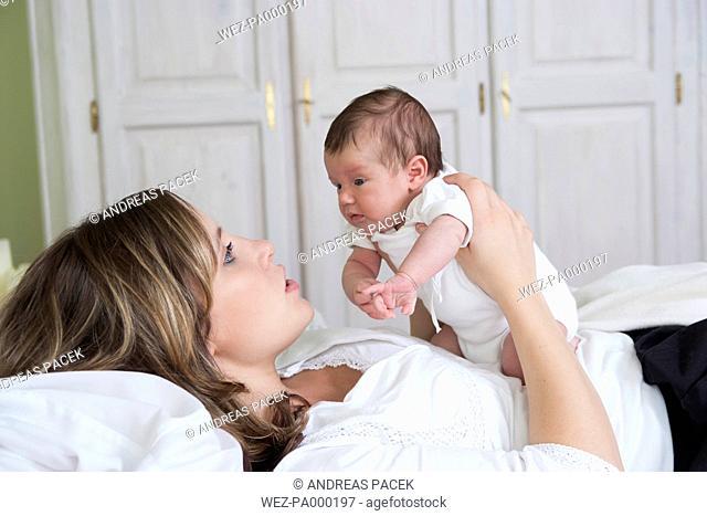 Mother watching her newborn daughter