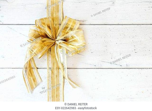 Shiny metallic golden bow