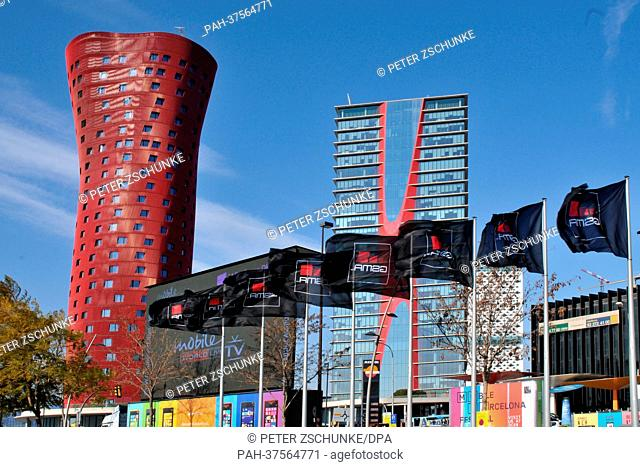 Flags of the organizer GSMA wave on the premises of the Mobile World Congress in Barcelona, Spain, 24 February 2013. The towers in the back were designed by...