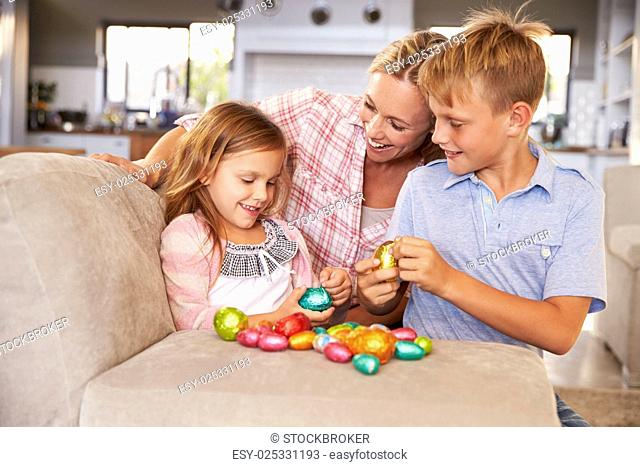 Mother celebrating Easter at home with kids