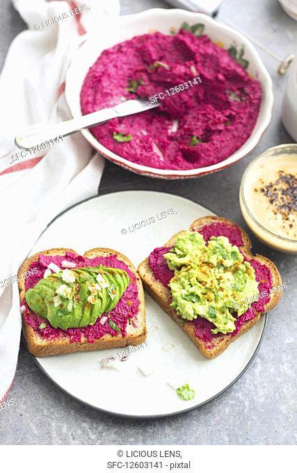 Beetroot hummus and avocado puree on toast