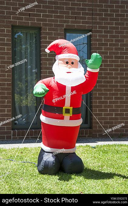 Christmas in the Antipodes: an inflatable Santa Claus set up in a suburban front yard, Melbourne