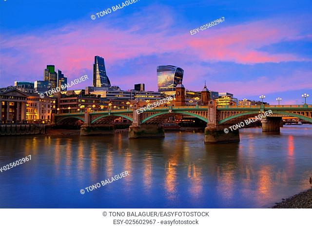 London skyline sunset in Southwark bridge at Thames river UK