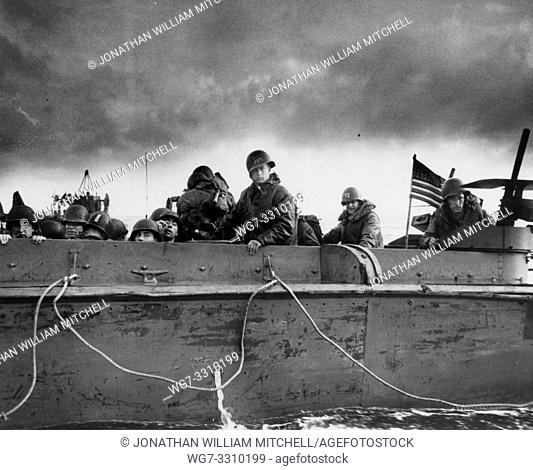 FRANCE Normandy -- 6 Jun 1944 -- US Troops and crewmen aboard a US Coast Guard manned LCVP as it approaches a Normandy beach on D-Day