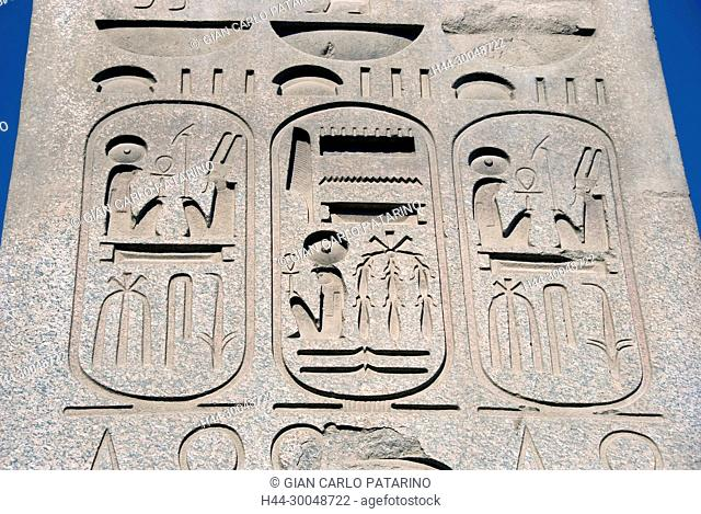 Luxor, Egypt. Temple of Luxor (Ipet resyt): the regalia of the pharaoh Usermaatra Setepenra Ramses II the Great (1303-1212 b.C.) carved in is obelisk