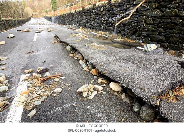 The A591, the main road through the Lake District, UK, completely destroyed by the floods from Storm Desmond. The road was breached in several places by...