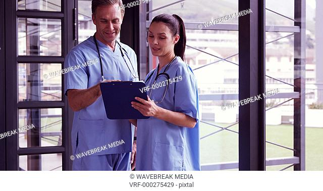 Medical team reading rapport on the clipboard