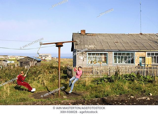 Children playing in Yuzhno Kurilsk town on Kunashir Island in the Kuril Island chain in Russian Far East