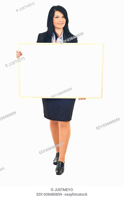 Smiling full length of business woman holding blank banner isolated on white background