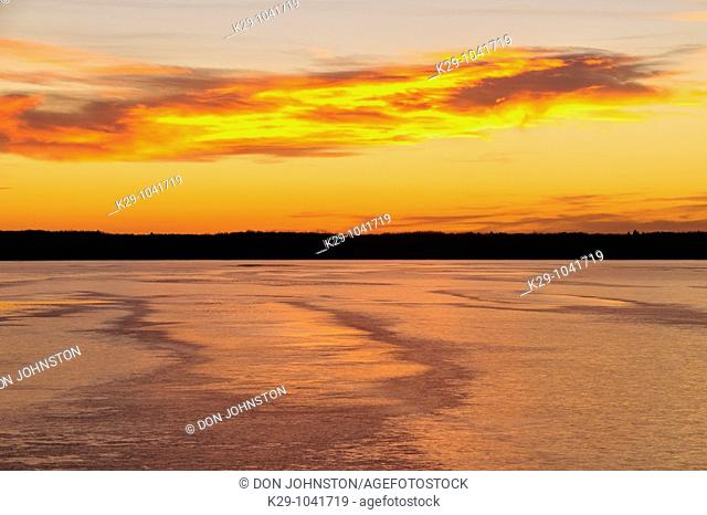 Ice-covered Audy Lake at sunset