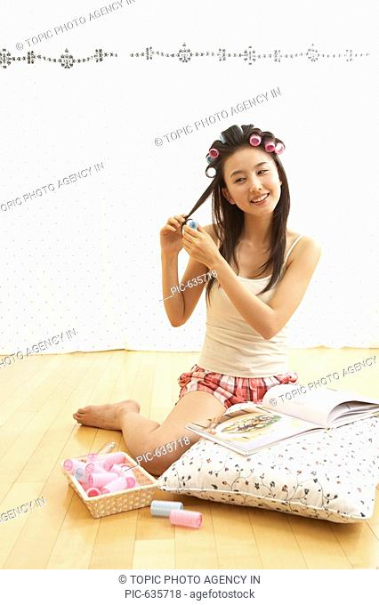 Young Woman in Hair Curlers,Korea
