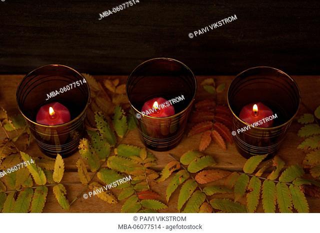 Three candles illuminates in twilight