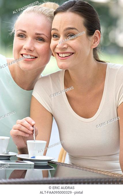 Friends having coffee together and gossipping
