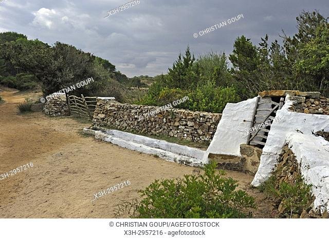 dry stone wall and wooden fences by the lagoon of s'Albufera des Grau Natural Park, Menorca, Balearic Islands, Spain, Europe