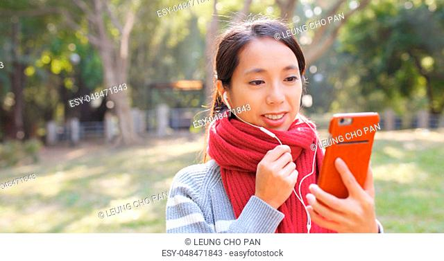 Woman talking on cellphone in the park