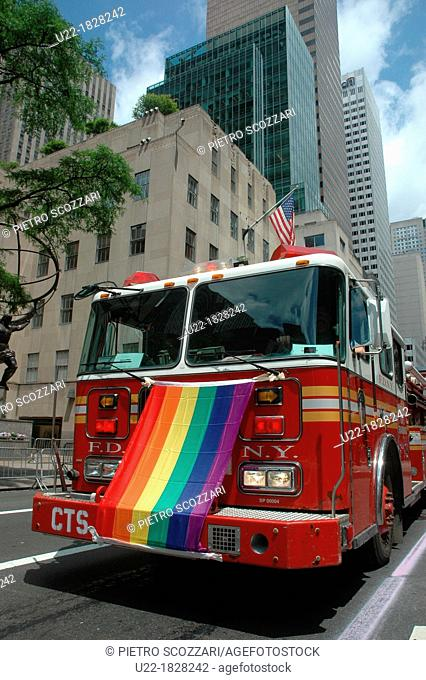 New York City, Manhattan, a firefighters truck with the LGBT flag at the Gay Pride March June