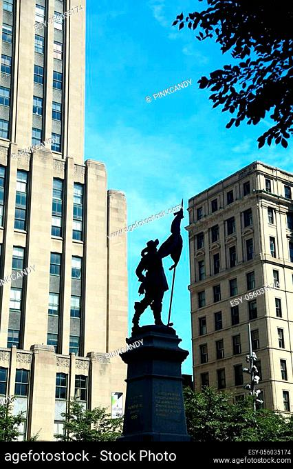 Silhouette of Maisonneuve Monument at Place d'Armes, Montreal, Quebec, Canada in front of Notre dame basilica Sculpture made in 1895 by Pierre-Phillipe Hébert