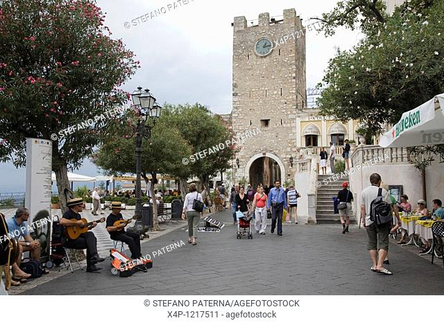 Piazza IX Aprile with the Torre dell Orologio clock tower, Taormina, Sicily, Italy