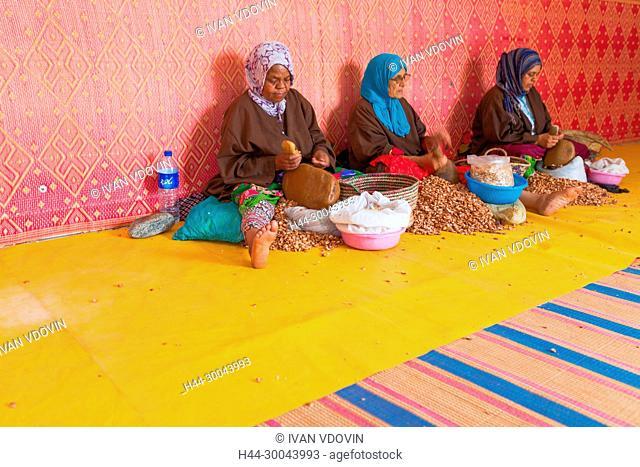Woman producing argan oil, near Essaouira, Morocco