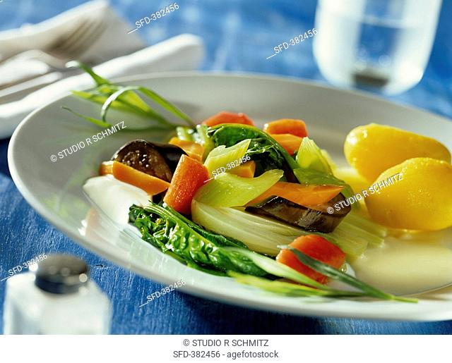 Colourful vegetables with potatoes and sour cream