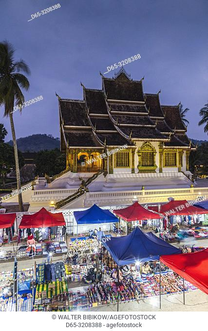 Laos, Luang Prabang, Sisavangvong Road, Handicraft Night Market and Wat Ho Pha Bang, evening