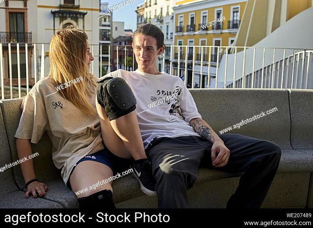 A young couple talking in the city