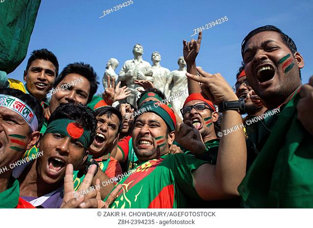 Bangladesh supporters celebrate on the streets of Dhaka after winning the 2015 ICC Cricket World Cup match against England and qualifying for the quarter final