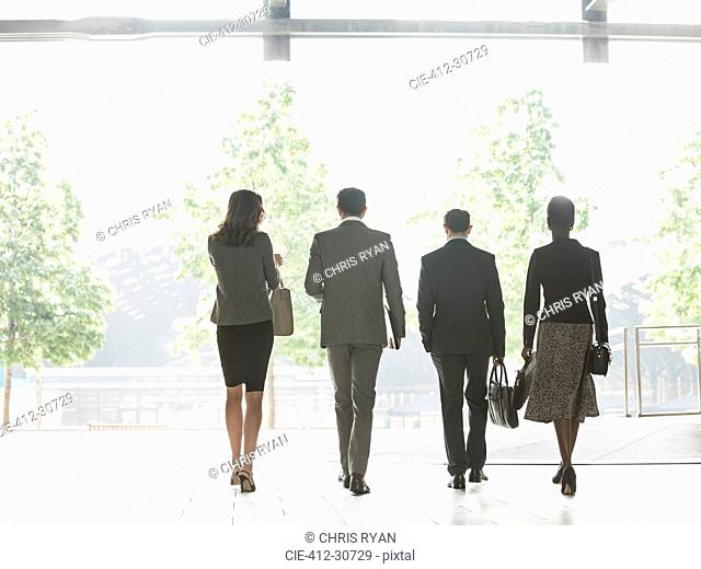 Corporate business people walking in a row