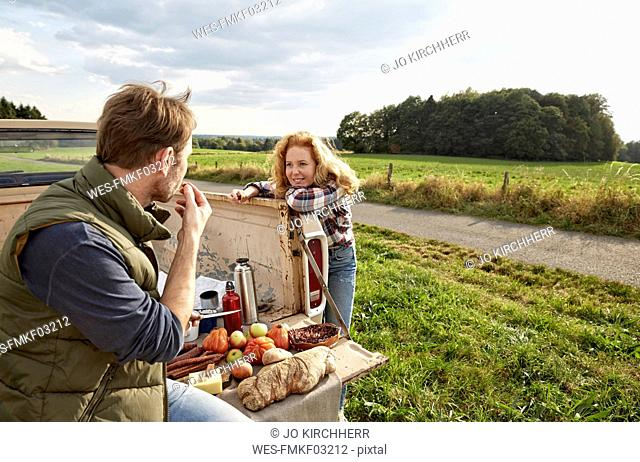 Couple with pick up truck having a picnic