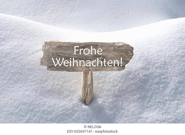 Wooden Christmas Sign With Snow In Snowy Scenery. German Text Frohe Weihnachten Means Merry Christmas For Seasons Greetings Or Christmas Greetings