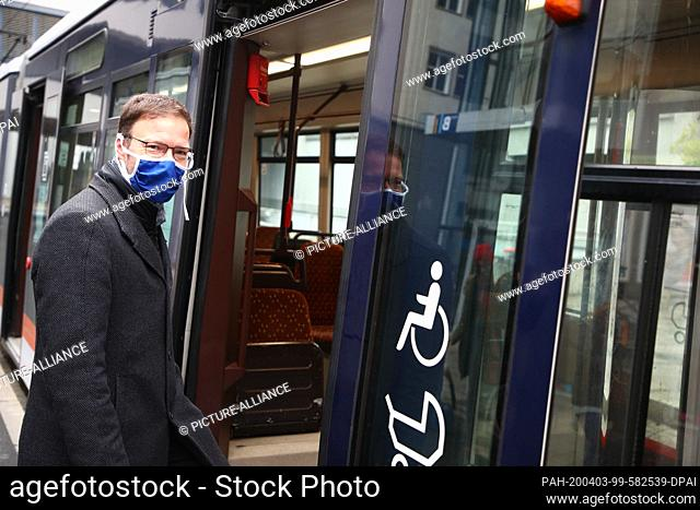 03 April 2020, Thuringia, Jena: Thomas Nitzsche (FDP), Lord Mayor, stands at a press appointment with a face mask on a tram. From 06.04