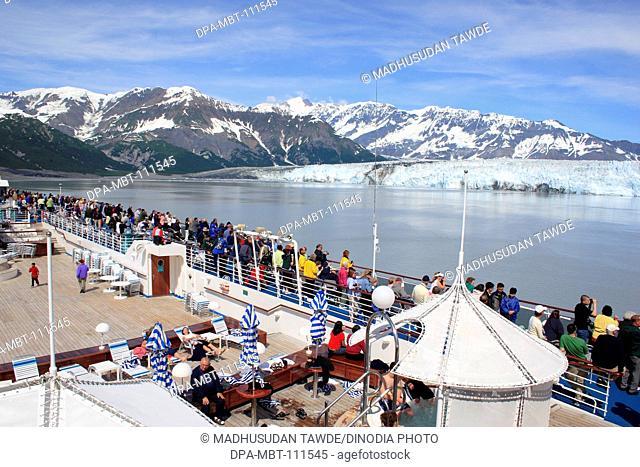 From cruise ship deck tourist watching Hubbard glacier and Saint Elias mountain; the longest tidewater glacier in Alaska; Saint Elias  national park ;...