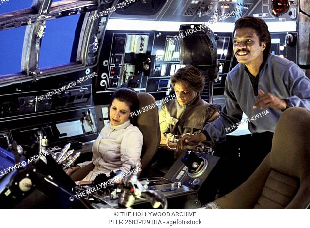 Carrie Fisher, Mark Hamill and Billy Dee Williams in the cockpit of the Millennium Falcon between takes in Star Wars Episode V: The Empire Strikes Back (1980)