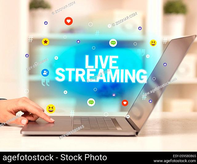 Freelance woman using laptop with LIVE STREAMING inscription, Social media concept