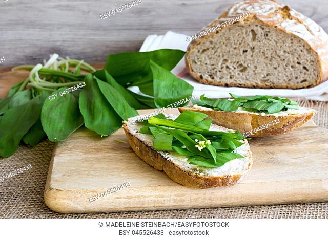Sourdough bread with butter and wild garlic leaves