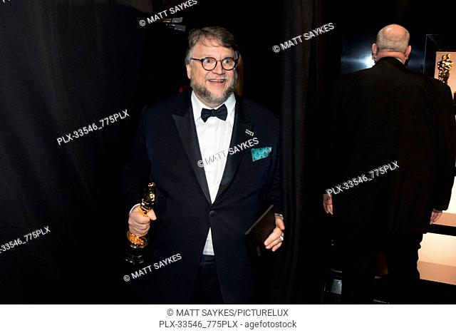 "Guillermo del Toro poses backstage with the Oscar® for achievement in directing for work on ""The Shape of Water"" during the live ABC Telecast of The 90th..."
