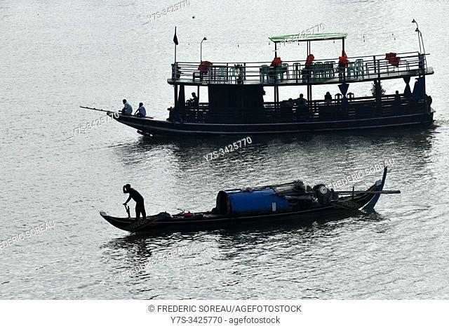 Fisherman boat on the Mekong river in Phnom Penh, Cambodia, South Esat Asia