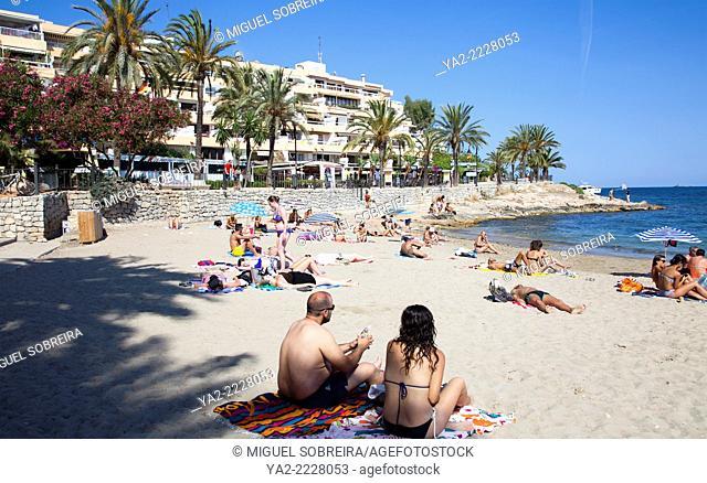 People on Figueretas Beach in Ibiza, Spain